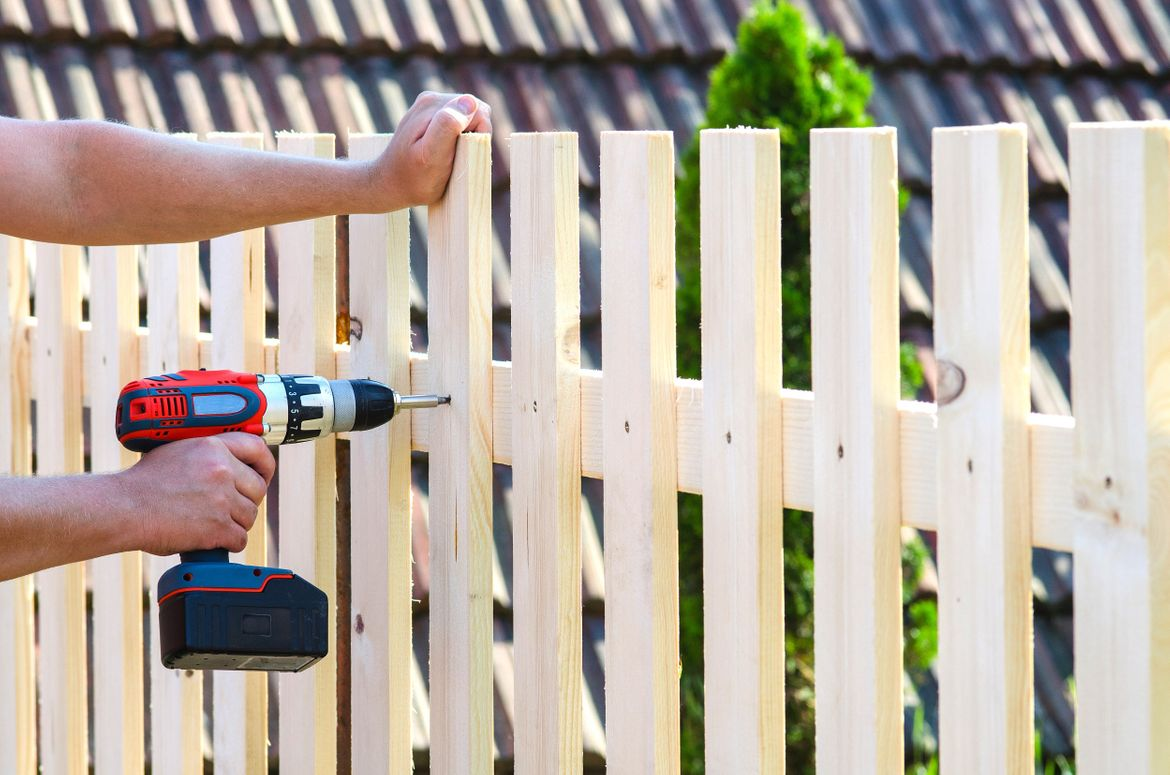 installing a brand new wood fence replacement in Edmonton